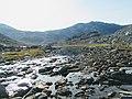 Stones by water Lille Malene hike near Nuuk Greenland.jpg
