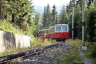 Štrbské Pleso–Štrba rack railway - Multiple unit 405.95 driving down to Štrba, near the Štrbské Pleso station
