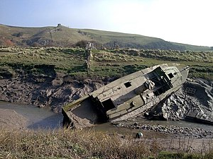 English: Stuck in the mud! An old boat going n...