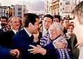 Suárez greets an old lady.jpg
