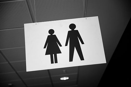 An image promoting gender equality, a man and woman holding hands, in Denmark