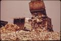 TRUCK PILING GARBAGE IN HACKENSACK MEADOWS DUMP BEHIND FT LEE. THE DUMP SERVES 250,000 BERGEN COUNTY RESIDENTS. IT... - NARA - 549749.tif