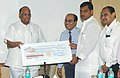 The Chairman, CWC, Shri B.B. Pattanaik presenting a cheque to Union Minister of Consumer Affairs, Food and Public Distribution and Agriculture, Shri Sharad Pawar, towards relief to Bihar's flood affected people, in New Delhi.jpg