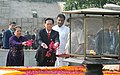 The Prime Minister of Socialist Republic of Vietnam, Mr. Nguyen Tan Dung and Madame Tran Thanh Kiem paying floral tributes at the Samadhi of Mahatma Gandhi, at Rajghat, in Delhi on October 28, 2014.jpg