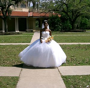 American bride wearing a Contemporary Western Wedding Dress.