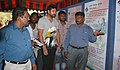 The noted cine star Jeyam Ravi going round the DAVP exhibition as part of ongoing voters' awareness campaign, at Anna Nagar, in Chennai on April 11, 2014. The Addl. DG, PIB, Chennai, Shri K.M. Ravindran is also seen.jpg