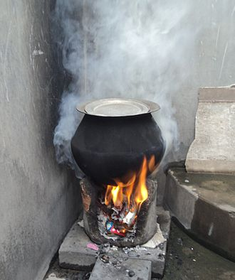 Air pollution in India - A rural stove using biomass cakes, fuelwood and trash as cooking fuel. Surveys suggest over 100 million households in India use such stoves (chullahs) every day, 2–3 times a day. Clean burning fuels and electricity are unavailable in rural parts and small towns of India because of poor rural highways and limited energy generation infrastructure.