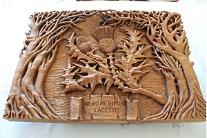 Nemo me impune lacessit - Thistle wood carving