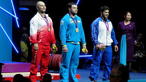 Weightlifting at the 2012 Summer Olympics – Men's 105 kg - Image: Three medallists