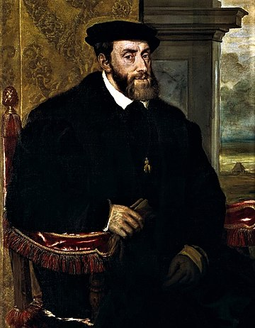 Charles V, Holy Roman Emperor, was born in Ghent Titian - Portrait of Charles V Seated (cropped) 2.jpg