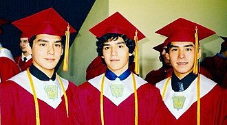 Multiple birth - Identical triplet brothers at graduation. Identical triplets are extremely rare.
