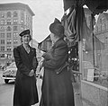 Two women in conversation on High Street by Holyoke City Hall (1941).jpg