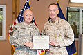 U.S. Army Gen. Martin E. Dempsey, left, the chairman of the Joint Chiefs of Staff, presents a Defense Distinguished Service Medal to U.S. Marine Corps Gen. Joseph F. Dunford Jr., the outgoing commander of 140826-D-HU462-366.jpg