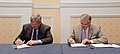 U.S. Department of Agriculture (USDA) Secretary Tom Vilsack (left), and Department of Transportation (DOT) Secretary Ray LaHood sign the Memorandum of Understanding (MOU) (2).jpg