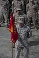 U.S. Marine Corps Cpl. Andrew Luna with Special-Purpose Marine Air-Ground Task Force Africa 13,holds the guidon during an awards and promotion ceremony at Naval Air Station Sigonella, Italy, April 2, 2013 130402-M-LZ697-014.jpg
