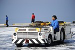 U.S. Navy Aviation Boatswain's Mate (Handling) 3rd Class Kimberly Prado drives an aircraft tow tractor on the flight deck of the aircraft carrier USS Harry S. Truman (CVN 75) March 9, 2014, in the Gulf of Oman 140309-N-LH273-025.jpg