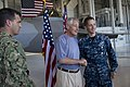 U.S. Navy Petty Officer 1st Class Dakota Martinez, right, assigned to the attack submarine USS Olympia (SSN 717), receives a coin and poses for a photo with Secretary of Defense Chuck Hagel at Joint Base Pearl 130530-F-MQ656-209.jpg