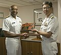 U.S. Navy Rear Adm. Frank Ponds, left, the commander of Navy Region Hawaii and Naval Surface Group Middle Pacific, trades gifts with Japanese Maritime Self-Defense Force (JMSDF) Rear Adm. Hideki Yuasa 130516-N-WX059-039.jpg