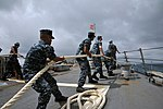 U.S. Sailors assigned to the guided missile destroyer USS McCampbell (DDG 85) heave lines as the ship moors in Okinawa, Japan, June 8, 2012 120608-N-TG831-171.jpg