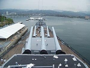 English: The USS Missouri (BB-63) watching ove...