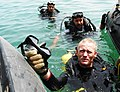 US Navy 030415-N-1050K-012 Master Diver, Master Chief Construction Utilitiesman David Daniels surfaces from a dive with his Kuwaiti counterparts during a recent joint debris clearing operation.jpg