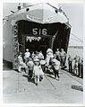 US Navy 030630-N-0000X-001 Vietnamese refugees board LST 516 for their journey from Haiphong, North Vietnam, to Saigon, South Vietnam during Operation Passage to Freedom, October 1954.jpg