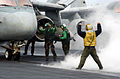 US Navy 030914-N-5555F-050 An Aviation Boatswains Mate directs an S-3 Viking assigned to the Screwbirds of Sea Control Squadron Thirty Three (VS-33) onto one of four catapults.jpg