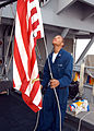 US Navy 040303-N-9392E-030 Signalman 3rd Class Kerry Ventress, of Streetport, La., raises the Jack Staff on the Signalman Bridge aboard the 7th Fleet command and control ship USS Blue Ridge (LCC 19).jpg