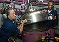 US Navy 040714-N-6920A-002 Airman Melanie Anaya, from Bronx, NY, and Airman Omar Thomas, from Miami, Fla., close the cover of a JP-5 fuel purifier.jpg