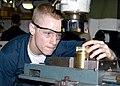 US Navy 040722-N-1238B-028 Machinery Repairman Fireman Richard Henegar, assigned to the amphibious assault ship USS Wasp (LHD 1) inspects a piece of metal on a milling machine.jpg