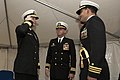 US Navy 041109-N-6477M-023 Cmdr. Timothy B. Spratto, right, renders a hand salute to Commander, Navy Region Northwest, Rear Adm. Hering during a change of command ceremony at Naval Station Everett.jpg