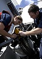 US Navy 041202-N-5837R-231 Fire Controlman 3rd Class Rose Gregory, left, and Fire Controlman 2nd Class Christian Blanco attach the loader assembly to a Close-In Weapons System (CIWS).jpg