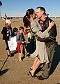 US Navy 041212-N-1294H-001 Lt. Cmdr. Phillip Clay embraces his wife during a homecoming celebration on board Naval Station Oceana, in Virginia Beach, Va.jpg