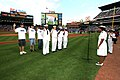 US Navy 050525-N-9907G-003 Commanding Officer, Navy Recruiting District (NRD) Atlanta, Cmdr. Vanessa Wyndham administers the oath of enlistment to NRD Sailors and Delayed Entry Program recruits at Turner Field.jpg