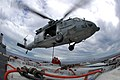US Navy 050627-N-5781F-039 Aviation Ordnancemen hook a cargo pendant to an MH-60S Seahawk helicopter.jpg