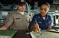 US Navy 050811-F-4883S-071 Peruvian Navy Lt.j.g. Gustavo Mejia, from the Peruvian frigate BAP Villavicencio (FM 52), listens as U.S. Navy Quartermaster 2nd Class Aurora Chavez explains the position of the guided missile cruiser.jpg