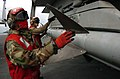 US Navy 051113-N-3488C-060 Aviation Ordnancemen inspect an inert AIM-7 Sparrow air-to-air missile, loaded on an F-A-18E Super Hornet.jpg