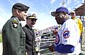 US Navy 060314-N-6999S-001 Director, Force Structure, Resources and Assessment (J8) Vice Adm. Evan M. Chanik, and his aid Col. Michael Linnington get a baseball signed by Chicago Cubs Manager Dusty Baker.jpg