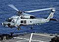 US Navy 060413-N-9898L-097 An SH-60B Seahawk helicopter assigned to the Saberhawks of Helicopter Squadron Light Four Seven (HSL-47) embarked USS Abraham Lincoln (CVN 72) performs a vertical replenishment.jpg
