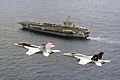 US Navy 070731-N-2193K-002 F-A-18E and F-A-18F Super Hornets fly by the USS Nimitz.jpg