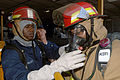 US Navy 070915-N-0989H-024 Mineman 1st Class Courtney Haralson, assigned to the High Speed Vessel (HSV 2) Swift, briefs members of the number one hose team before entering the port engine room during a fire drill.jpg