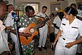 US Navy 071019-N-0000X-001 Musician 1st Class Luslaida Barbosa and the Commander, Naval Forces Europe - Commander, Sixth Fleet (CNE-C6F) rock band, Topside, play with local Congolese musicians.jpg