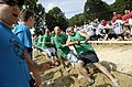 US Navy 080813-N-8467N-005 Sailors assigned to Naval Submarine Support Facility New London's weapons department participate in the annual tug of war competition.jpg