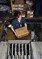 US Navy 080901-N-6139L-159 Storekeeper Seaman Samantha Herila loads food stores onto an elevator.jpg