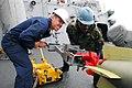 US Navy 080929-N-2013O-001 Gunner's Mate 1st Class Justin McConnell and Gunner's Mate 2nd Class Lamar Varnedoe upload a torpedo.jpg