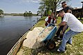 US Navy 090404-N-5328N-195 Volunteers from the Center for Information Dominance (CID) Corry Station in Pensacola help reinforce the bulkhead in the back yard of Lee Jones after torrential rains swelled the Blackwater River and.jpg