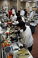 US Navy 090730-N-4698K-258 Navy Culinary Specialists rush to prepare their dishes before the clock runs out during the 2009 Commander, Navy Region Southeast Iron Chef Competition.jpg