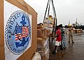 US Navy 100403-N-6138K-825 Sailors assigned to Naval Mobile Construction Battalion (NMCB) 7 and Assault Craft Unit (ACU) 2 offload Project Handclasp material.jpg