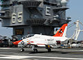 US Navy 100514-N-3620B-003 A T-45C Goshawk test aircraft assigned to the Salty Dogs of Air Test and Evaluation Squadron (VX) 23 lands aboard the aircraft carrier USS Enterprise (CVN 65).jpg