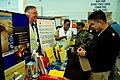US Navy 100520-N-3242C-097 Steve Paschal speaks with Senior Chief Religious Program Specialist Ronald Genova during the Health, Fitness, Recreation and Safety Fair.jpg